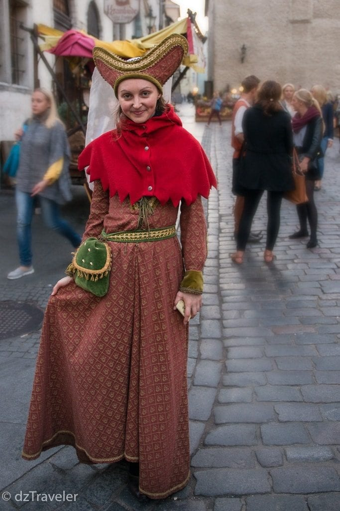 A girl in Old Town Tallinn with a traditional costumes